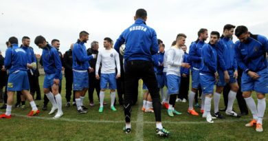 Kosovo's national football team players get ready to take part in a training session in Obilic, on March 4, 2014, one day ahead of their first international friendly match. Kosovo are gearing up for their FIFA-approved debut on the international scene when they play a friendly match against Haiti, the first in their six-year history as an independent state. AFP PHOTO / ARMEND NIMANI